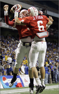 Katy quarterback Bo Levi Mitchell, seen here celebrating with teammate Joey Fuda after a touchdown, threw three scoring strikes to help the Tigers capture their fifth state title and fourth in the last decade.