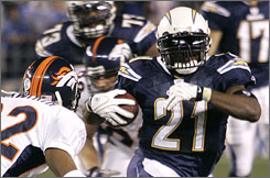 Chargers running back LaDainian Tomlinson ran for 107 yards and a touchdown in San Diego's 23-3 defeat of the Denver Broncos.