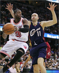 Zydrunas Ilgauskas and the Cleveland Cavaliers bottled up Dwyane Wade in the second half of a 96-82 victory over the Miami Heat on Christmas Day.
