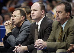 Jim Boylan, far right with former Bulls head coach Scott Skiles, center, and fellow assistant Ron Adams on Nov. 20 in Denver, has 14 years of NBA experience but none as a head coach.