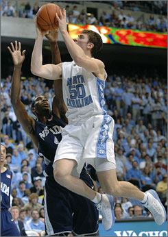 Tyler Hansbrough drives as Nevada's Demarshay Johnson defends during the North Carolina-Nevada game in Chapel Hill. Hansbrough finished with a game-high 26 points for the top-ranked Tar Heels.