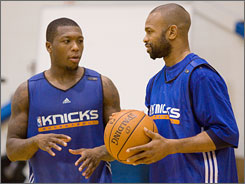 Knicks guard Nate Robinson, left, gets some pointers from boxer Roy Jones Jr. during Friday's workout.