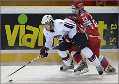 Kyle Okposo battles for the puck during Team USA's win over Russia in Saturday's preliminary-round game at the world junior hockey championships in the Czech Republic.