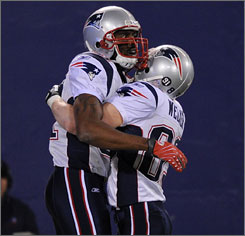 Randy Moss, left, and Wes Welker caught 31 of Tom Brady's record 50 touchdown passes this season.