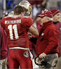 Florida State coach Bobby Bowden tells quarterback Drew Weatherford what he wants done during the Music City Bowl in Nashville. FSU lost to Kentucky 35-28 as Bowden suffered his first defeat in nine December postseason games.