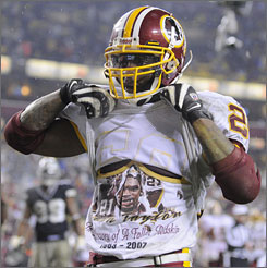 Redskins running back Clinton Portis revealed his T-shirt with the late Sean Taylor's image after scoring a touchdown against Dallas on Sunday.
