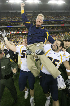 West Virginia's interim coach Bill Stewart got the ride of his football life after his Mountaineers beat Oklahoma in the Fiesta Bowl.