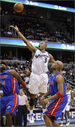 Wizards swingman Caron Butler attempts a scoop shot against Pistons defenders Antonio McDyess (24) and Jarvis Hayes, right, Wednesday in Washington. Butler and teammate Antawn Jamison are carrying the Wizards in Gilbert Arenas' absence.
