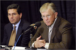 Redskins coach Joe Gibbs, right, with team owner Daniel Snyder addressing the death of safety Sean Taylor on Nov. 27, guided his team to a playoff berth after the loss of the Pro Bowler.