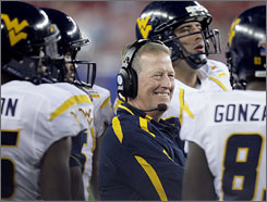 West Virginia coach Bill Stewart watches the Fiesta Bowl unfold from the sidelines. His reward for a 48-28 win was the removal of the interim tag from his title.