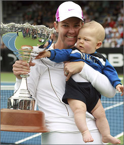Lindsay Davenport holds son Jagger and poses with her trophy after winning the ASB Classic.