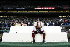 """Redskins defender LaRon Landry, who became the starting free safety after Sean Taylor's death, reflects on the loss. Said teammate London Fletcher: """"I can't believe it's over with for us. It just seemed our story was going to be written all the way to the Super Bowl for us."""""""
