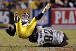 Jacksonville's Rob Meier flips Steelers quarterback Ben Roethlisberger for a sack during the third quarter. Roethlisberger was sacked five times and threw three interceptions on Saturday.
