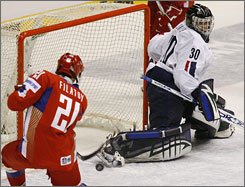 "Russia's Nikita Filatov scores one of his two gaols against United States goalie Jeremy Smith. After the loss, a dejected American coach John Hynes said he believes ""it comes down to pride in competing for your country ... we didn't have the right mix of guys to do that."""