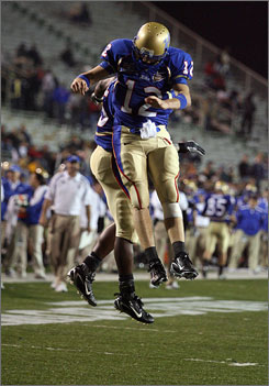 Tulsa quarterback Paul Smith (12), seen here celebrating with teammate Tarrion Adams after scoring a touchdown in the third quarter, set an NCAA record with his 14th consecutive 300-yard passing game.