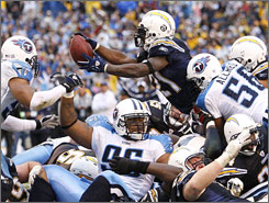 Chargers running back LaDainian Tomlinson sealed San Diego's wild-card win over the Titans with a second effort on this fourth-and-goal leap midway through the fourth quarter.