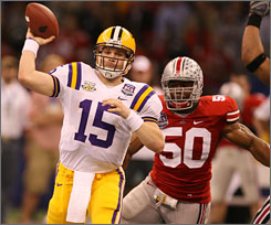 LSU quarterback Matt Flynn threw for four touchdowns to lead a team effort by the Tigers against Ohio State.