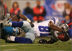 Terrell Owens injured his ankle on this play against Carolina on Dec. 22. His status for Sunday's playoff game against the N.Y. Giants in uncertain.