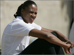 Marion Jones takes a break at the Mt. San Antonio Relays in Walnut, Calif., in April of 2005.