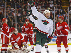 The Wild's James Sheppard celebrates one of his team's five goals in regulation against the Red Wings.