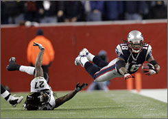 Patriots receiver Donte' Stallworth dives for a key first down during the fourth quarter.