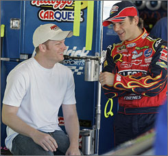 Dale Earnhardt Jr., left, gets better acquainted with new teammate Jeff Gordon during last week's test session at Daytona.