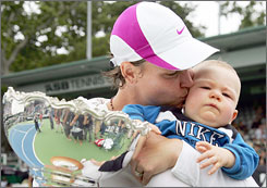 Lindsay Davenport kisses Jagger while holding the trophy for winning the ASB Classic in New Zealand early this month. Davenport has just returned to the pro tour after taking time for the baby's birth last June.