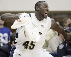 Pitt's DeJuan Blair celebrates Monday's 69-60 victory over Big East rival Georgetown. The freshman wound up with 15 points and nine rebounds.