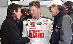 Dale Earnhardt Jr. gets better acquainted with Hendrick Motorsports racing director Ken Howes, right, and engine specialist Scott Maxim during a break in preseason testing.