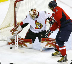 Senators goaltender Ray Emery was able to make the save on this play, but Alexander Ovechkin came back in the third period to score the tiebreaking goal and lead the Capitals to a 4-2 win.