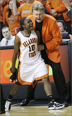 Oklahoma State's Andrea Riley and coach Kurt Budke celebrate an 82-63 victory over Oklahoma Saturday at Gallagher-Iba Arena. Riley scored 45 points in the win.