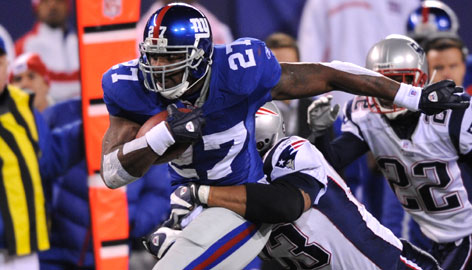 At 6-4 and 264 pounds, Brandon Jacobs is counted on to soften up opposing defenses in the first half of games.
