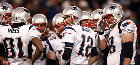"Patriots quarterback Tom Brady set multiple records in New England's perfect regular season. Says receiver Randy Moss, with whom Brady connected for a record 23 touchdowns, Brady is ""going out there determined to kill you at any given time. They can give you fourth-and-24, and Tom's still ready to kill you."""