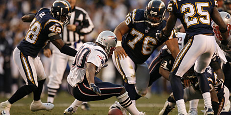 This fumble by Marlon McCree (obscured in lower right) prevented the Chargers from locking up a win in last year's divisional playoffs against New England. The safety and his San Diego teammates return to Foxborough for a rematch with the undefeated Patriots in Sunday's AFC title game.