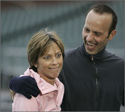 Brian Boitano and Dorothy Hamill laugh during a press conference ahead of their show at AT&T Park in San Francisco last year.