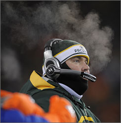 Packers cold Mike McCarthy had several layers protecting him from the below-zero temperatures on Sunday.