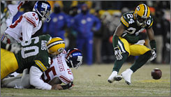 Green Bay's Jarrett Bush could not recover this fumble by New York's R.W. McQuarters in the fourth quarter.