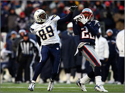 Asante Samuel intercepts a pass from San Diego's Philip Rivers during the first half on Sunday.