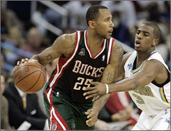 "Point guard Mo Williams (25) sets up the Bucks offense against Hornets defender Chris Paul on Monday in New Orleans. ""I have a home here (in Milwaukee),"" Williams said. "" I'm happy here and, obviously, you've got to think about your family."""