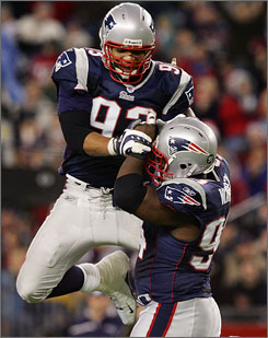 Richard Seymour, left, and Ty Warren, both former first-round picks, are two of the three homegrown products that anchor the Patriots' defensive line.