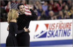 "Tanith Belbin and Ben Agosto enjoy their first-place routine after the ice dancing free skate, a performance Belbin called ""the best we've done in years."""