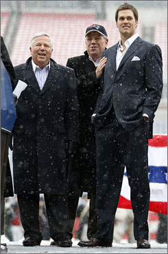Tom Brady, right, looked fine walking in his dress shoes before the Patriots left to travel to the Super Bowl.
