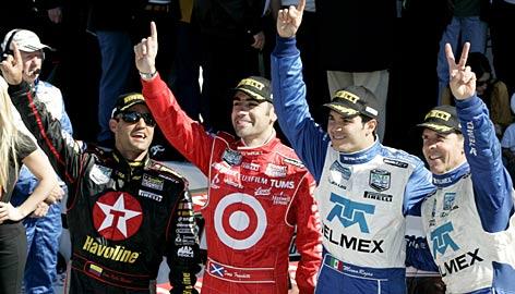 Winning drivers (from left) Juan Pablo Montoya, Dario Franchitti, Memo Rojas and Scott Pruett celebrate their 24-hour triumph in Daytona International Speedway's victory lane.