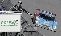 Scott Pruett crosses the start-finish line to complete the 695th and final lap at Daytona.