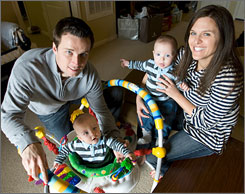 Giants kicker Lawrence Tynes stayed with his wife Amanda during her pregnancy with twins Caleb, in jumper, and Jaden.