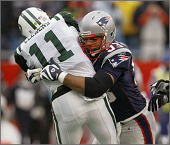 "Patriots defensive lineman Richard Seymour, here taking down Jets QB Kellen Clemens on Dec. 16, says he plays ""within the rules"" despite a recent accusation of dirty play from the Chargers' Nick Hardwick."