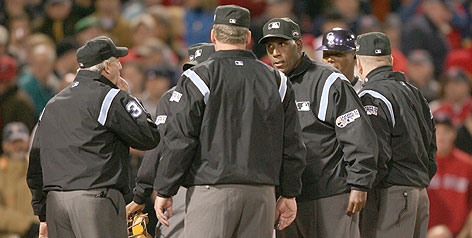 Umpires met at home plate in Fenway Park before Game 2 of last fall's World Series. The umps' union is upset with what it believes is inappropriate questioning during baseball's background checks of the men in blue.