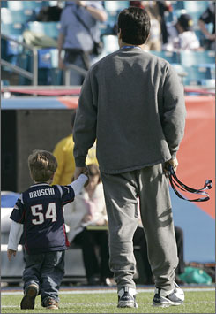 Patriots linebacker Tedy Bruschi walked his son Rex around Alltel Stadium in Jacksonville before the Super Bowl in 2005. He plans to add his two other children to his Super Bowl ritual on Sunday.