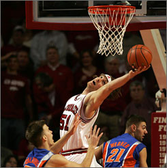 Arkansas' Steven Hill grabs a rebound over two Gators in the paint during the Razorbacks' big win over 19th-ranked Florida.