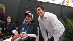 Cleveland Browns quarterback Brady Quinn takes a snapshot with 16-year-old Zack McDonald, who's the guest of the NFL and the Make-A-Wish Foundation at Super Bowl weekend.